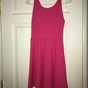 Pink sleeveless skater dress